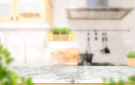 White marble texture table top on blurred kitchen background for montage or display your products