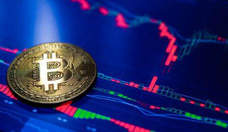 Bitcoin. Crypto currency Bitcoin, BTC, Bit Coin. Bitcoin golden coins on a chart. Blockchain technology, bitcoin mining concept Foto de archivo