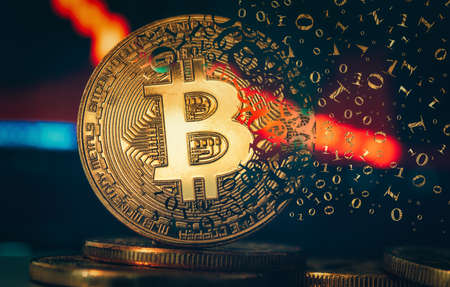 Crypto currency golden coin. Gold bitcoin falling apart. Concept of a cryptocurrency market crisis and defocused chart background. Foto de archivo