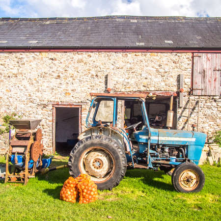 Tractor, apples and an apple mill at  an organic farm in England Reklamní fotografie