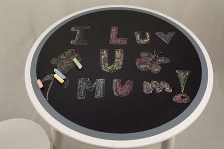 s day: Mother s Day message chalk over a blackboard Stock Photo