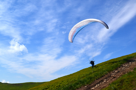 Skydiver on parachute in  clear sky parachuting stock image photo Stock Photo