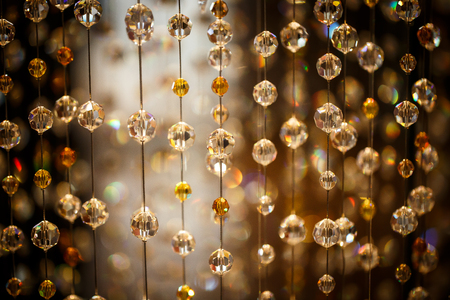 lustre: crystal balls hanging on nylon strings, studio shot Stock Photo