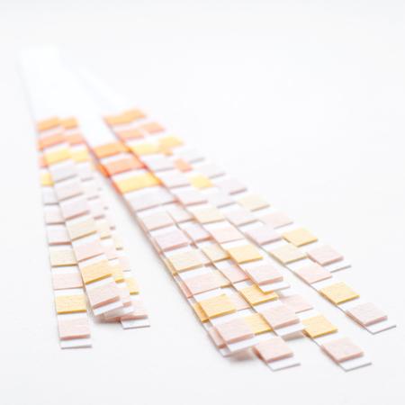 titration: Many test strips for semiquantitative analysis on white background Stock Photo