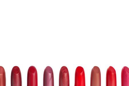 Background with lipsticks set isolated on white