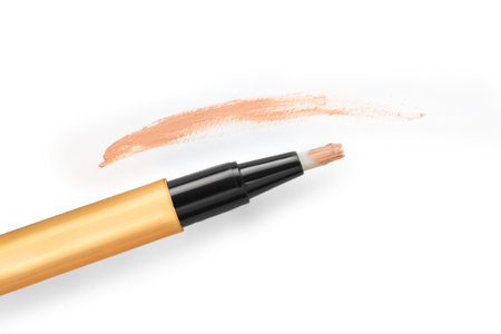 concealer: Corrective concealer with stroke isolated on white background