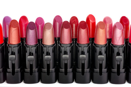 the lipstick: Row of red lipsticks isolated on white