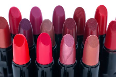 Group of various lipsticks in tubes on white Stock Photo