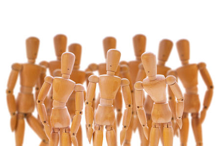 collegial: Scene with group of wooden dummies isolated on white.