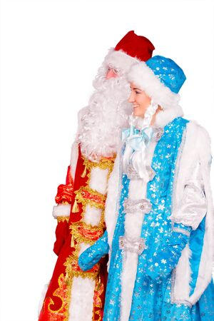 snegurochka: Russian Christmas characters: Ded Moroz (Father Frost) and Snegurochka (Snow Maiden) with gifts bag studio shoot. Isolated on white