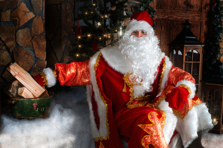 'ded moroz': Ded Moroz (Father Frost) - traditional Christmas character sitting on the porch Stock Photo