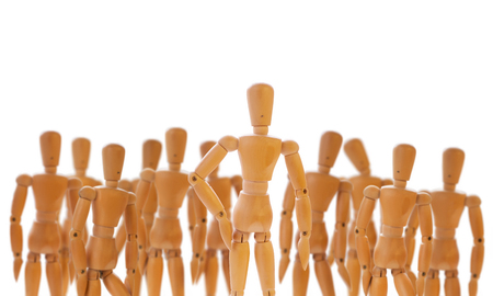 dummies: Character standing in front of a defocused crowd. Wooden dummies isolated on white.