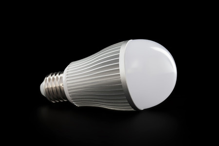 e27: Lying LED E27 bulb isolated on black with clipping path