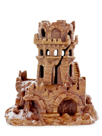 catacomb: Bronze figure of a medieval ruined keep isolated on white with clipping path Stock Photo