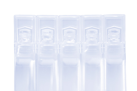 ampules: Modern plastic BFS (Blow Fill Seal) ampules pack. Isolated on white with clipping path.