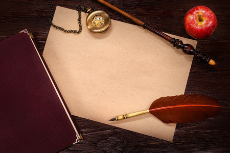 role: Vintage still-life with copy space. Role playing, steampunk or fantasy concept. On wooden table background