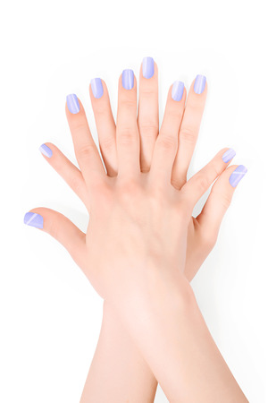 shellac: Hands with violet shellac art manicure isolated on white with clipping path