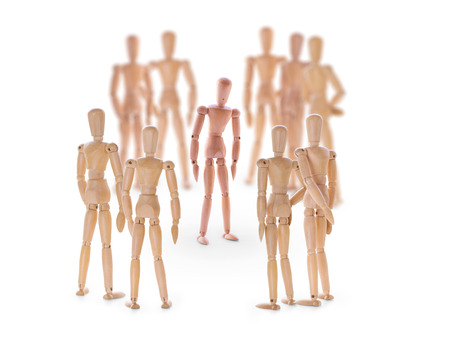outcast: Dummy characters. Different one in center of the crowd. On white background. Standing out from the crowd, outcast in a team or character under pressure concept