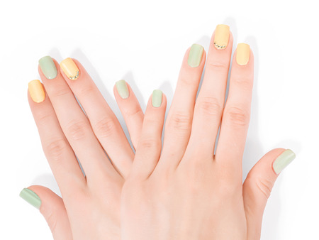 shellac: Two woman hands with art shellac manicure and rhinestones. Isolated on white, clipping path included