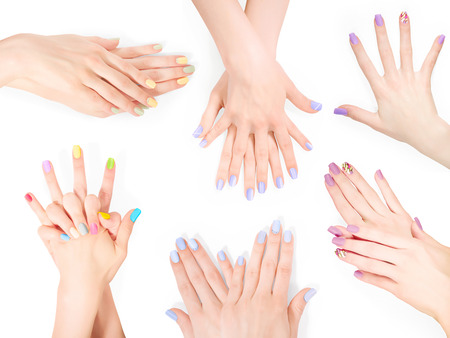 shellac: Bundle of hands with creative shellac art manicure. Isolated on white
