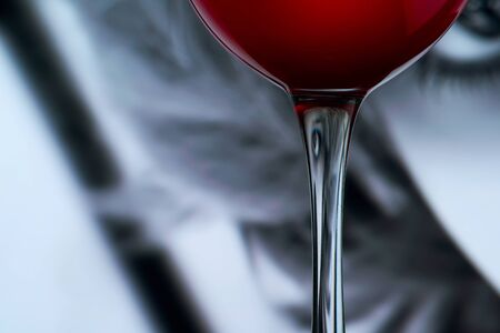 presence: Distorted face into wine glass stem. Surreal presence concept