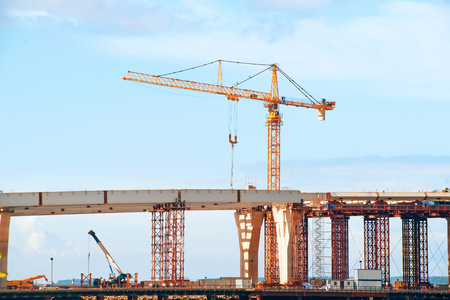 Bridge under construction. Tail crane, elevated road and construction frame Stock Photo