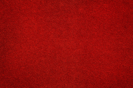 Red felt surface close up. Abstract texture and background