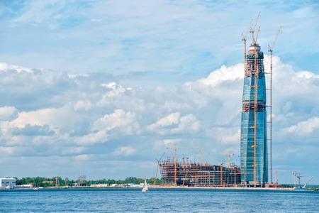 SAINT PETERSBURG. RUSSIA - JUNE 25 2017. Multipurpose center Lakhta (Gazprom headquarters) under construction. Sea side view against cloudy sky Editorial
