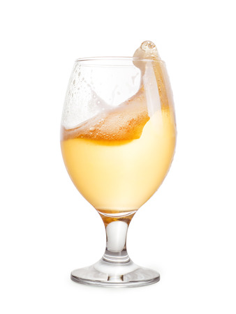brewery: Splash of light beer into glass. Isolated on white, clipping path included