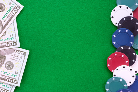 Dollar notes and poker chips on green felt. Casino and gamble theme background and template