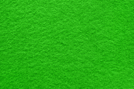 Green felt table surface extremal close up. Huge macro texture and background