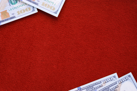 Dollars on red felt table. Template and background Standard-Bild