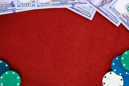 Dollars and poker chips on red casino felt table background. Frame with copy space composition Stock Photo