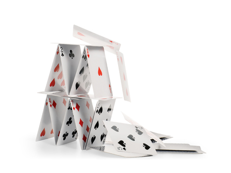 Crashed house of cards. Falling cards isolated on white, clipping path included 免版税图像 - 103025884
