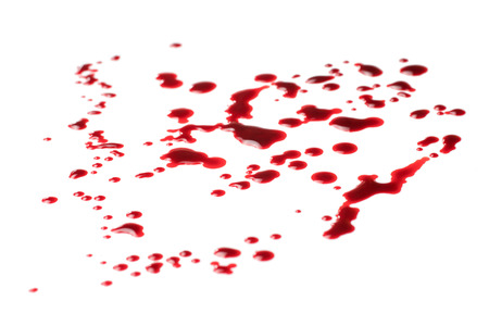 Spilled blood. Blood drops, isolated on white background, angle view selective focus
