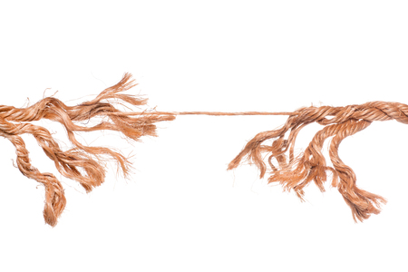 Frayed strained rope near to break. Isolated on white
