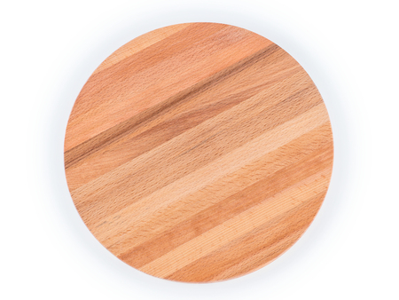 Round wooden cutting board top view. Isolated on white, clipping path included Stock fotó