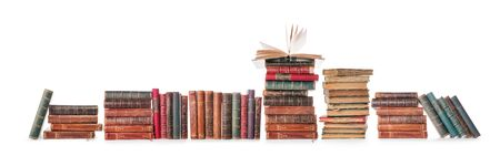 Long old books row isolated on white, clipping path included Фото со стока