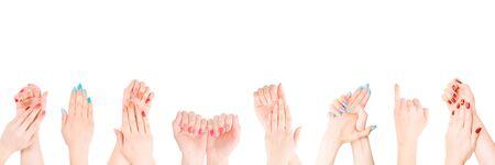 Mani di donna con smalto colorato in fila. Isolato su bianco, percorso di ritaglio incluso Archivio Fotografico