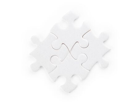 Four white puzzle pieces. Isolated on white, clipping path included