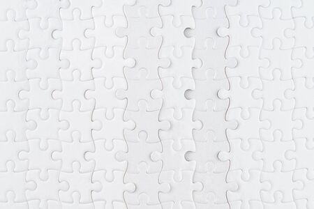 White jigsaw puzzle close up. Background and texture