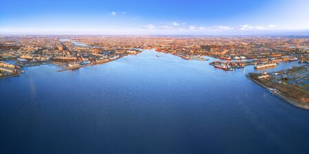 Panoramic aerial view of the seaside of Saint Petersburg, Russia. Industrial landscape with sea port at sunset Stock Photo