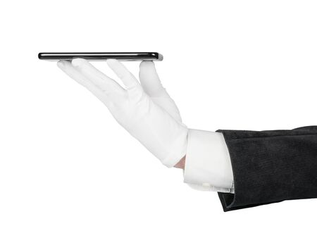 Man hand in black suit and white glove giving smartphone to someone. Isolated on white, clipping path included Banque d'images - 129698953