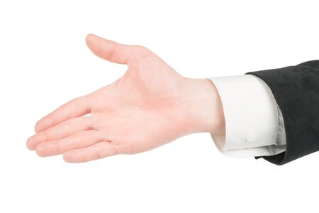 Man in suit hand offering for handshake gesture. Isolated on white, clipping path included