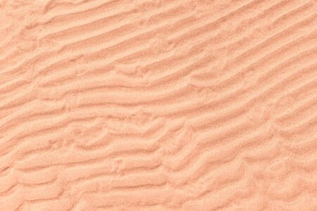 Wet sand surface with wave natural pattern. Natural texture and background Stock Photo