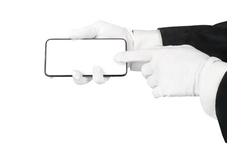 Man hands in suit and white gloves using smart phone. Isolated in white with clipping path, copy space on the smartphone screen Stock Photo
