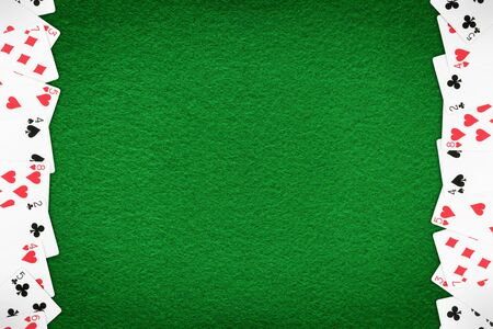 Green casino felt table with cards row. Gambling theme template and background