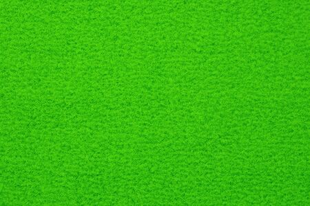 Green spotted surface close up. Texture and background