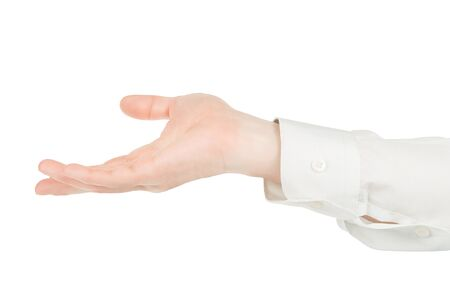 Man hands in white shirt holding something. Isolated on white, clipping path included Stock Photo