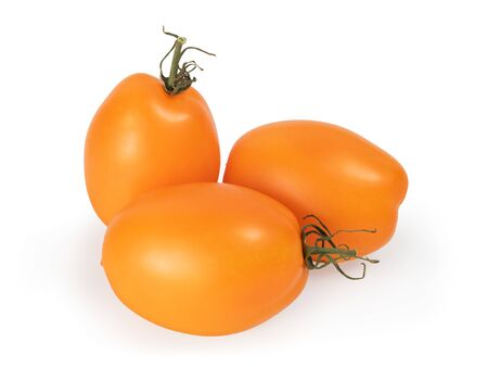 Group of orange tomatoes close up isolated on white